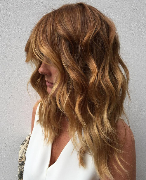 caramel layered hair with golden blonde highlights