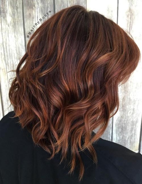 layered dark brown hairstyle with medium brown highlights