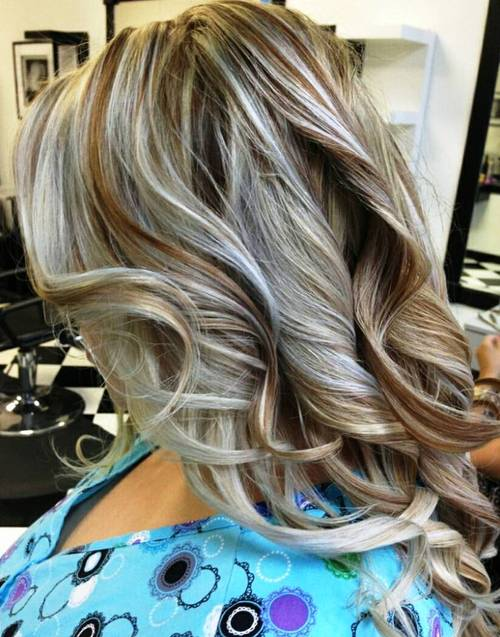 brown blonde curly hairstyle with honey highlights