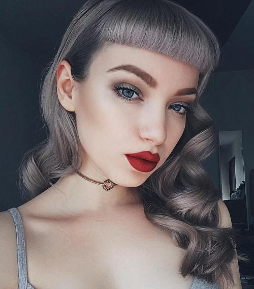 Curly Gray Pin Up Hairstyle With Bangs