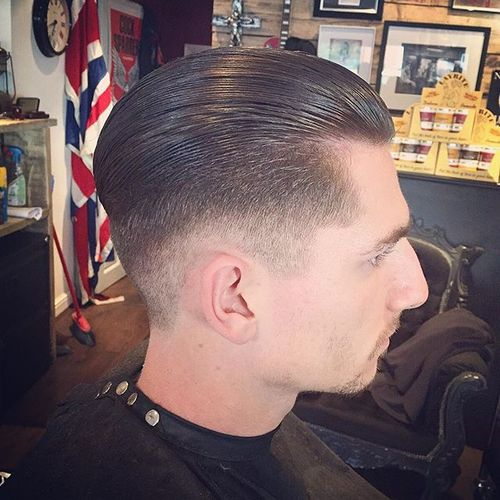 sleeked back long top tapered sides hairstyle