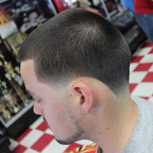 one length military haircut with faded temples and nape