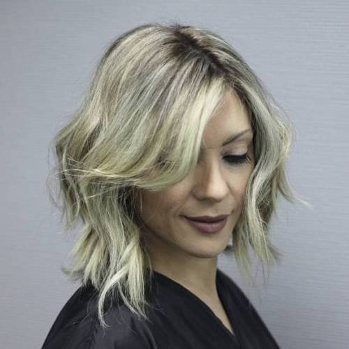 Medium Razored Haircut For Wavy Hair