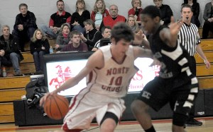 Raider Bennett Holley sidesteps an Evangel defender to drive to the paint Wednesday night.