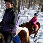 Anna on Dakota and Amanda on Huey
