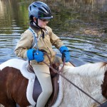 Alex on Dakota in a pond.  Just a quick water stop for the ponies.