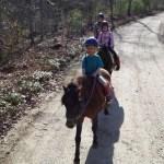 Amanda riding Huey without help