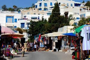 Travel Tunisia . Roadway and market.