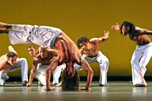 """03/18/2009 New York, NY (Culture) - Alisson Silveira (center, in HANDSTAND) and fellow members of DanceBrazil performing in """"Ritmos"""" at the Skirball Center at NYU Theater today. Assignment #30078407A Andrea Mohin/The New York Times/Redux  Published 03-23-2009: DanceBrazil members performing Jelon Vieira's """"Ritmos."""" (Andrea Mohin/The New York Times/Redux"""