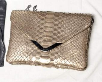 jpg FALL 2011 TREND ALERT: THE ENVELOPE CLUTCH   The Sche Report / Margaret Sche