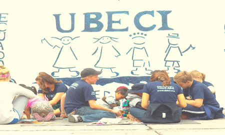 UBECI volunteers working with the children. Image credit: UBECI website.