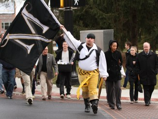 The Marauder leads students, faculty and alumni to the Biemesderfer Center for welcoming.