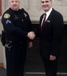 Sgt. Bryan Cummins, MUPD with Chancellor John C. Cavanaugh in 2011.
