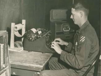 Photo courtesy of Dr. Walter Kreider, Dr Walter Kreider, Snapper Alum, writing for his army newspaper.