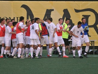 Mens' Soccer celebrates a goal. Photo courtesy of MUAthletics.