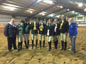All of the students who competed at the first Intercollegiate Horse Show Association competition of the semester placed. Team members stand proudly showing their winning ribbons. (Photo courtesy of Miranda Snyder)
