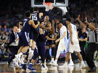Villanova's Kris Jenkins is mobbed after winning the game with a buzzer beater. Photo courtesy of wikipedia.