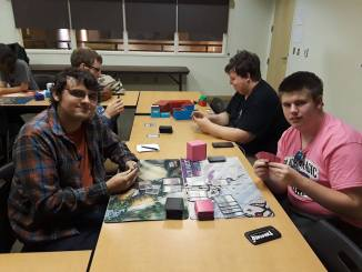 Cole Vohs (front left) competes against his fellow player in a strategic and thrilling (Photo courtesy of Maria Glotfelter).