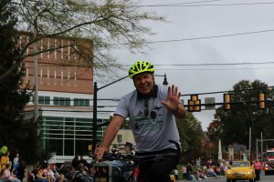 Millersville University President Dr. Anderson joins the parade riding his bicycle, something he is well known for around campus.