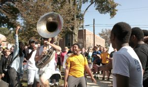 Connor Devlin on sousaphone dancing with students at the strike (Photo Courtesy of Kaylee Rex).