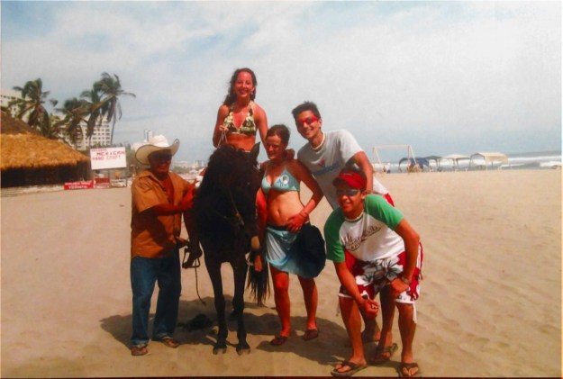 My triumphant ride on the beach complete with a Mexican cowboy and friends to make sure I didn't fall off.