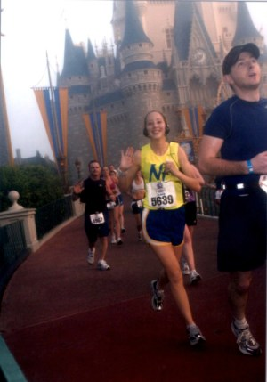 Running by the Magic Kingdom in my first marathon. Happy as a clam.
