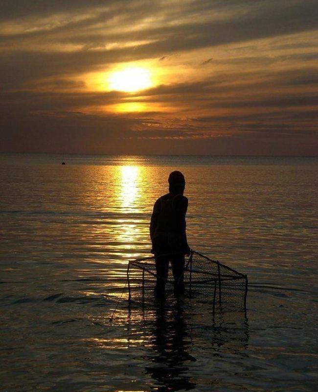 Visit Jamaica: Land I Love. Lobster catcher in Negril Jamaica.