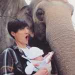 April on the go: Baby and Jaeoo with an elephant