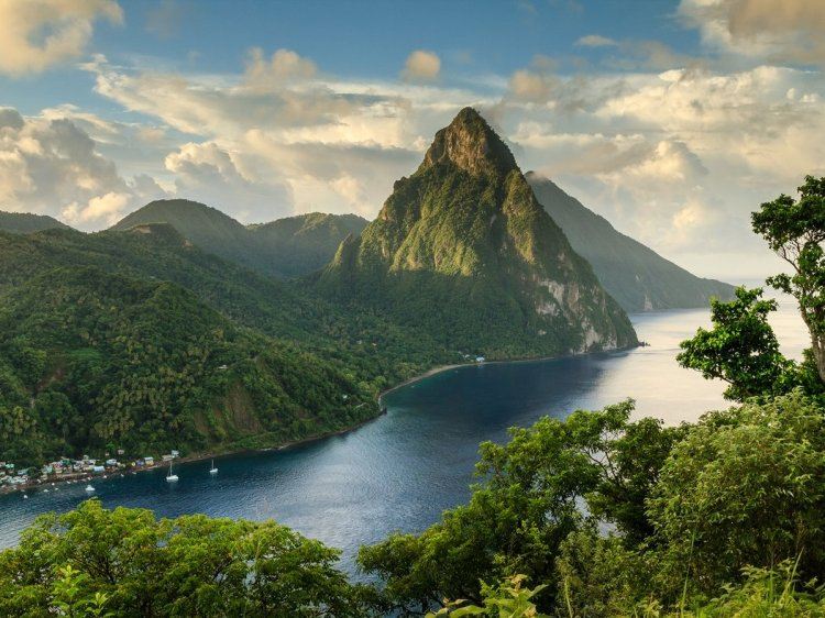 "St. Lucia | Overall Rating: 80.569: Nature doesn't get more photogenic than St. Lucia's Pitons, two mountainous volcano spires on the southern end of the island. Covered in lush rainforest and luxurious resorts, the Caribbean country is a popular honeymoon spot. Pro tip: Check out Anse Cochon (""Bay of Pigs""), accessible only by boat, to swim, dive, or snorkel over an unspoiled reef and a shipwreck."