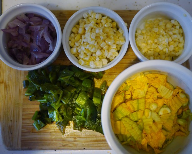 Clockwise from top left: Red Onion, Corn, Squash Blossoms and Roasted Peppers.