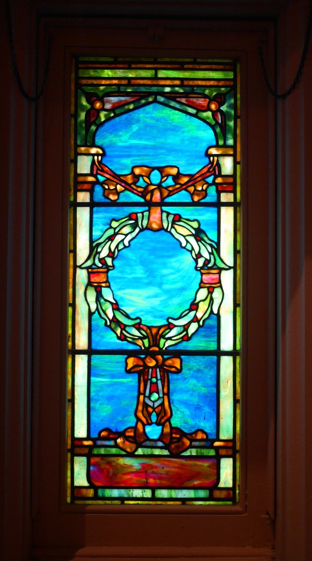 The stained glass in the church was one of the inspirations for the wedding's color palette.