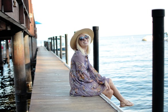 Stefanie Schoen of The Style Safari wears Target Lilac floral tiered dress, flat brim straw hat, summer style