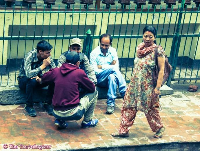 Kathmandu street photography Woman Walks, Men Talk, Thamel, Kathmandu - Kathmandu Street Photography thetraveloguer.com