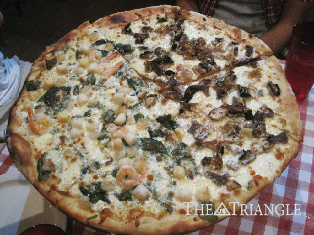 Pizza Rustica offers over 33 varieties of toppings for their pies including combinations like like Pesci di Formaggio (shrimp and scallops) and ribeye and portobello. A large pizza with gourmet additions like these is only $19.99, while more traditional pies goes for less.