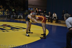 Junior 149-pounder Shane Fenningham matches up against Max Mayfield of Iowa State University last season at the DAC. Fenningham won in a 5-3 decision.