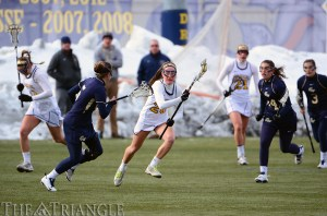 Sophomore midfielder Emily Duffey (center) makes a run versus George Washington University on February 16. Duffey has racked up nine goals and three assists in ten games this season, including the Dragons' first of the game versus Penn State Wednesday.