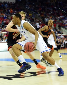 Duke's Jabari Parker (white jersey) drives against Mercer University in the second round of the 2014 NCAA Tournament. (Bob Donnan - USA Today Sports Images)