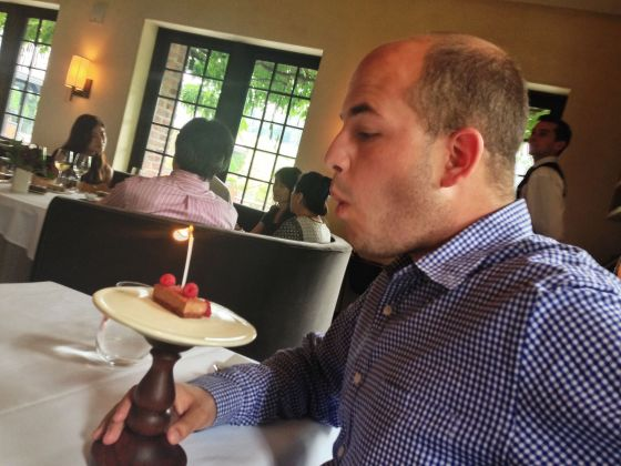 brian blowing out birthday candle at blue hill stone barns