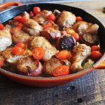 chicken with shallots in skillet, flat shot