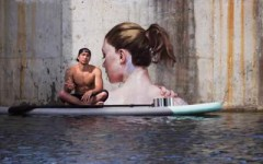 Sean Yoro Photogpahed With One Of His Semi-Submerged Murals