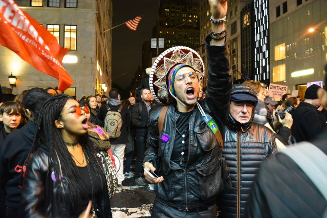 Anti-Trump protester by Trump Tower on Wed. Nov., 9 in NYC. (Photo: The Urban Watch/ Demi Vitkute