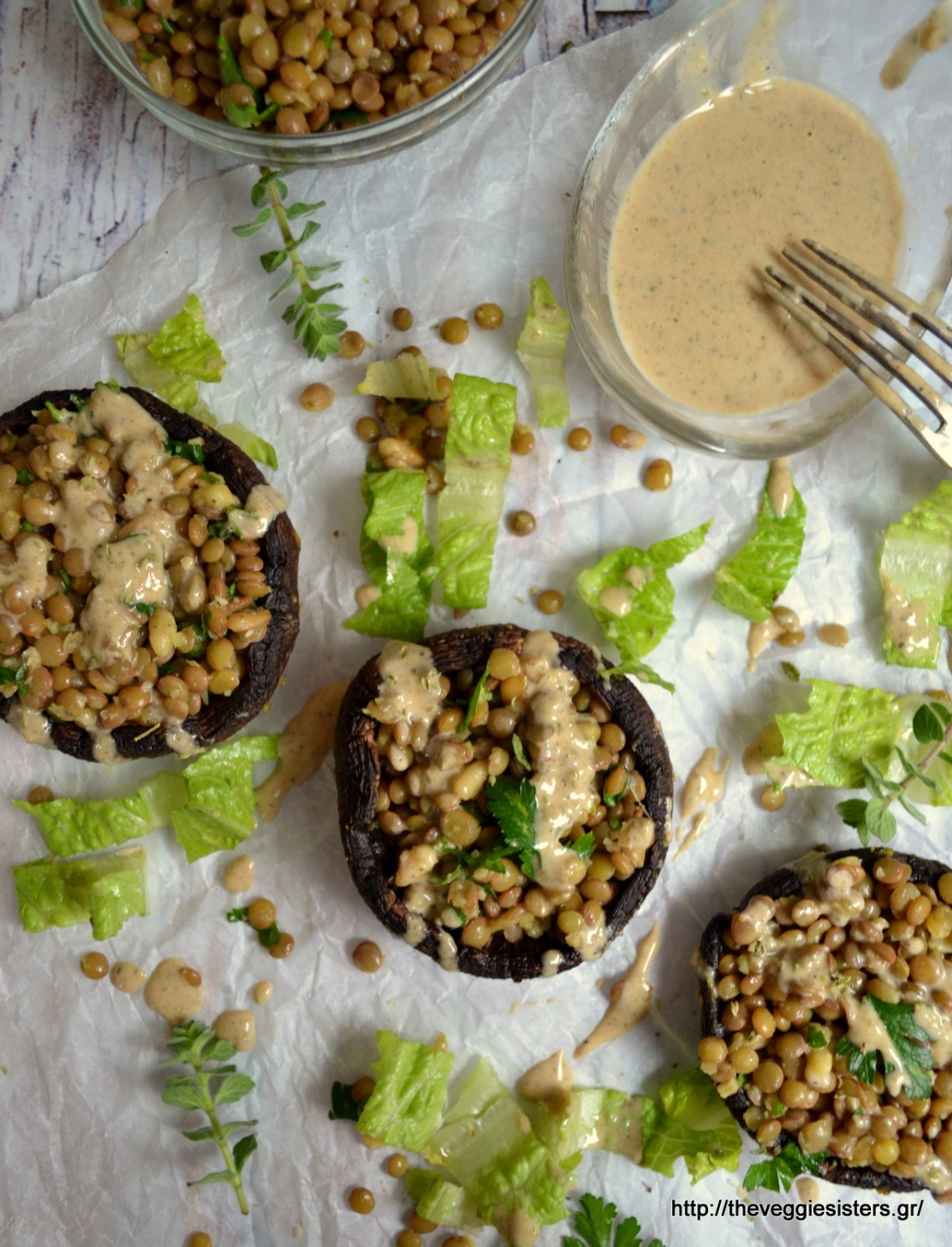 Lentil stuffed portobello with tahini sauce