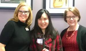 Ally staff member posing with Nina Phouthasack and Lynn Wehrman of WeCo.