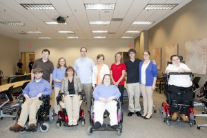 WeCo staff members posed for a group photo in a conference room.