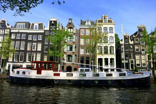 10 PLACES TO VISIT IN EUROPE THIS SPRING: The trees lining Amsterdam's lovely canals start to sprout green leaves again after their winter nap, and the city comes back to life. Residents rush outdoors to soak up each ray of sunshine at the city's canal side cafes.