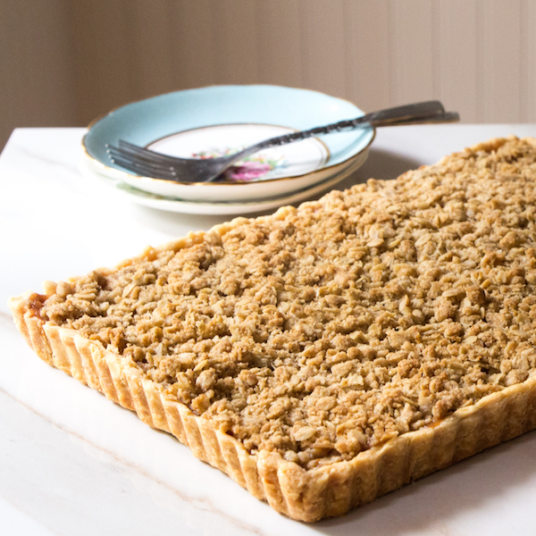 Apple Pie Bars with apples, pears, and raisins in a buttery crust with crumble topping.