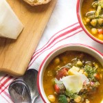 Chickpea stew loaded with roasted peppers, tomatoes, onions, and wilted Swiss chard. Serve with a drizzle of pesto.