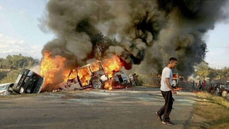 Imphal East: Angry people set on fire vehicles in Imphal East district on Sunday in protest against the United Naga Council (UNC)'s indefinite economic blockade. PTI Photo (PTI12_18_2016_000154B)