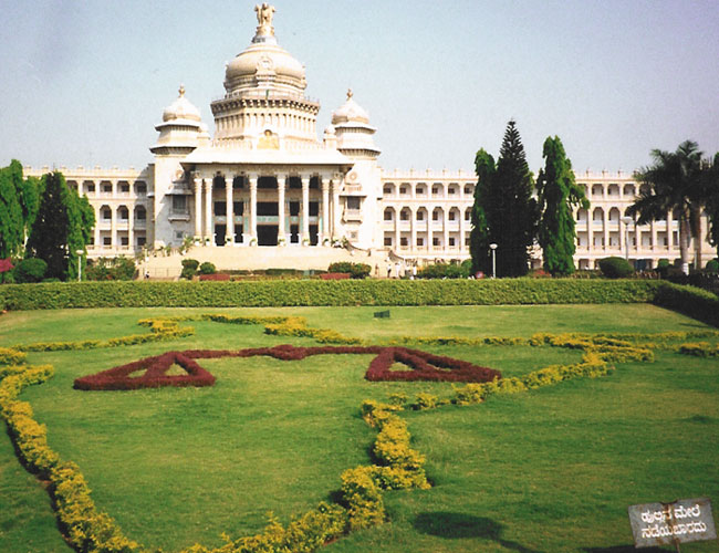 "Bangalore. It is called ""Vidhana Soudha"". You could call it as Karnata Parliament Building.   The sign in the bottom right reads ""Do not walk on grass"""