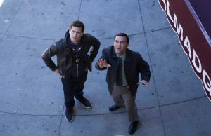 "BROOKLYN NINE-NINE: L-R: Joe Lo Truglio and Andy Samberg in the ""Hostage Situation"" episode of BROOKLYN NINE-NINE airing Tuesday, Jan. 5 (8:30-9:00 PM ET/PT) on FOX ©2015 Fox Broadcasting Co. Cr: John P Fleenor"